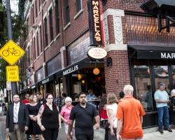 People walking outside Marcella's in the Short North