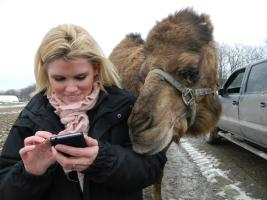 taking a selfie with a camel at Hidden Valley Animal adventure