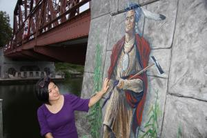 Woman with murla along Erie Canal