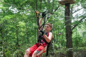 Boy on ZipZone zip line
