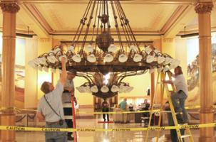 Changing light bulbs in rotunda chandelier Kansas Statehouse