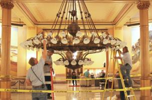 changing-light-bulbs in rotunda chandelier