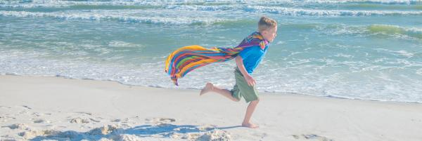 kid running on beach