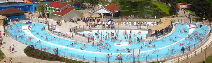Landscape picture of the park-goers floating along the Idlewild Lazy River water feature