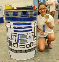 Photo of girl with R2D2 painted barrel