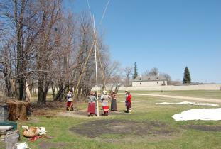 Interpreters setting up a tipi at Lower Fort Garry National Historic Site