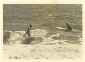 1966 Carolina Beach, NC, Joseph Skipper Funderburg surfing, Sonny Danner paddling, Funderburg