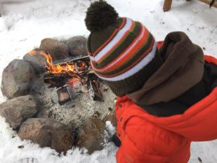An outdoor bonfire is a warm welcome to Riding Mountain National Park.