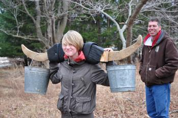 Learn how colonial Americans carried buckets full of sap during Maple Syrup Days (credit: Hendricks County Parks & Recreation)