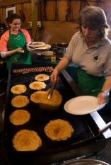 Pancakes being prepared at Mapleland Farms in Salem, N.Y. This month New York is offering a sweet and sticky treat for visitors as 110 of its maple producers, including Mapleland Farms, join together for the 16th Annual Maple Weekend (http://www.mapleweekend.com/).  Credit: Darren McGee, NYS Dept. of Economic Development