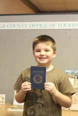 Nathan Walker, Herman Avenue Elementary, gets his 'Passport to History' stamped at the Cayuga County Office of Tourism