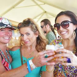 Women having drinks at a festival in the Outer Banks NC