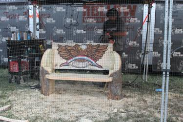 Jason Emmons creates art with a chainsaw.