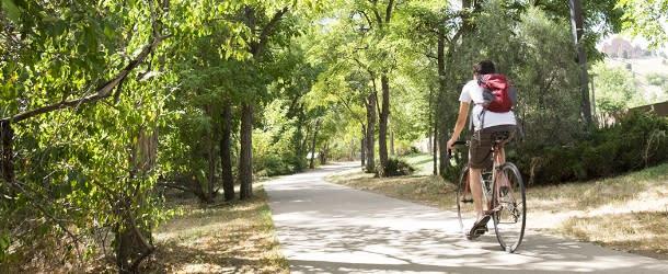 Man Biking the Boulder Creek Path