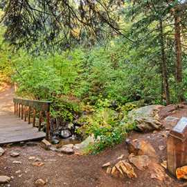 The start of the trail: a short bridge and memorial. photo by Kyle Jenkins