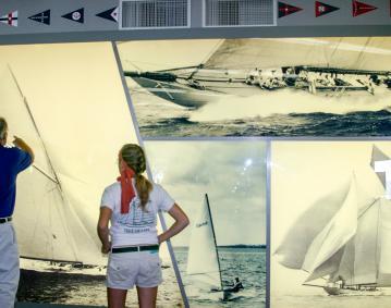 https://res.cloudinary.com/simpleview/image/upload/crm/newportri/herreshoff-boat-photo-display_credit-Herreshoff-Marine-Museum_ea0c4646-5056-b3a8-49bc338eb9f9a3f2.jpg