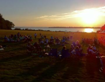 https://res.cloudinary.com/simpleview/image/upload/crm/newportri/music-at-sunset0_c49629ea-5056-b3a8-49d827264c1209dd.jpg