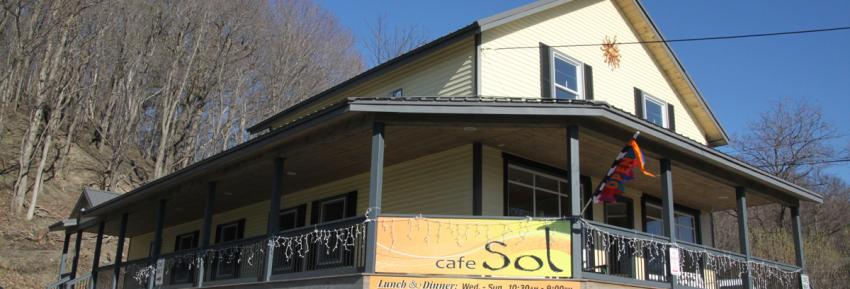 cafe-sol-canandaigua-exterior-rocks-porch-sign.jpg