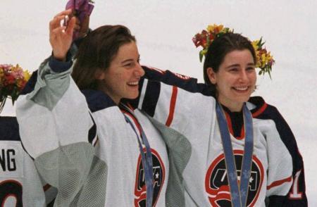 Sara DeCosta celebrating team USA women's hockey medal with teammate