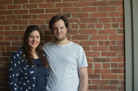 Chef Ben Sukle and wife Heidi in front of brick