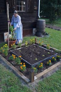 Pioneer woman tending garden at Sams House's Pioneer Day. Photo Credit: Brevard EELS