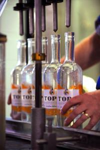 Top of the Hill Distillery filling bottles.jpg