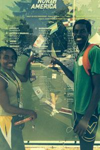 Nelda and Kyron from the IVB find their country, flag, and names on display at Hayward Field