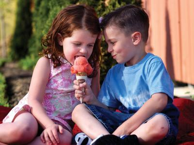 Young boy & girl sharing Graeter's ice cream cone
