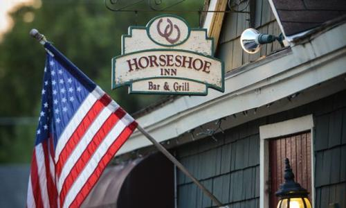 Horseshoe Inn exterior with sign and flag