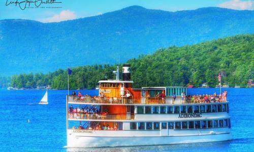 Lake George Shoreline Cruises Boat with Sailboat