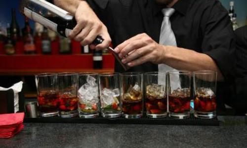 87 North Staffing Bartender pouring drinks