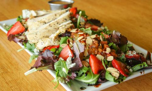 Juicy Burgers & More Burger summer salad with pita and strawberries