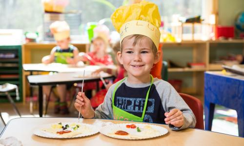 Saratoga Independent School boy with chef's hat
