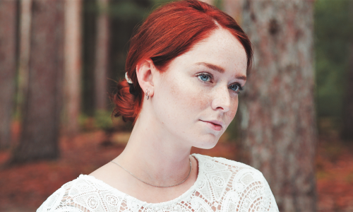 Original Vessel head shot of woman with red hair