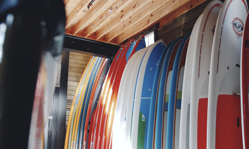 Original Vessel surfboards lined up on wall