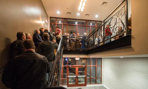Caffe Lena crowd on stairs