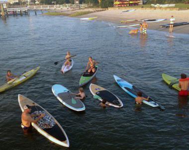 People on paddleboards and kayaks during Surf 2 Sound