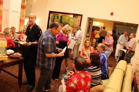 people celebrate in the lounge of the Hilton Garden Pittsford