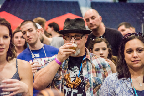 Man drinks beer at the Rochester Real Beer Expo