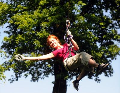 Girl ziplining at treetop quest