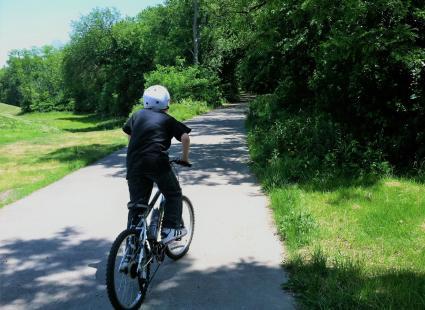 Ohio River Greenway, boy on bike
