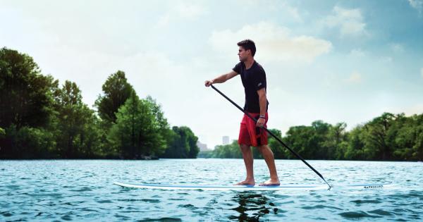 Man paddle boarding on Lady Bird Lake