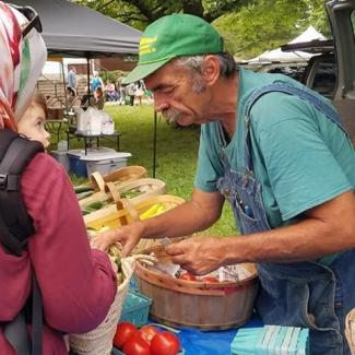 Local vendors offer up fresh produce at the Plainfield Chamber Farmers Market.