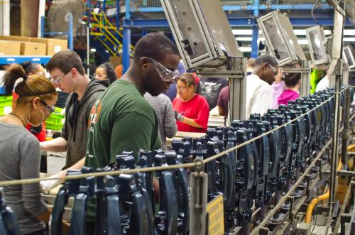 Workers on the factory line inside ADAC Automotive in West Michigan
