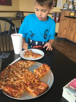 We love the thin crust at Pizza Paradise!