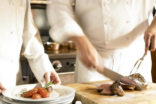 Image of chef carving steak at Bywater Restaurant