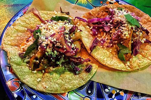 Two tacos on festive plate