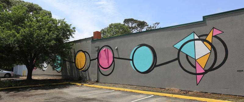 Artist ScubaVirginia Beach, VAGeometric circles, lines and peace crane on grey wall.