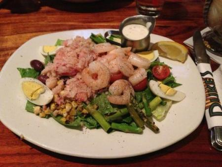 Can't pick between seafood and salad? Duke's Shrimp and Crab Salad offers the best of both worlds! (Photo courtesy of Shannon C. / Yelp)