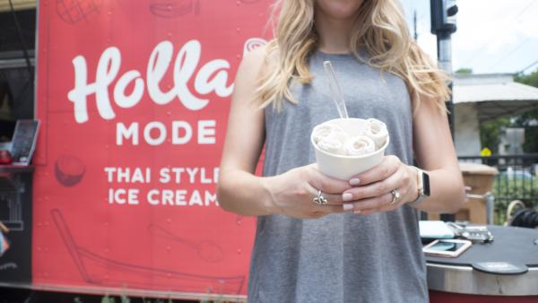 Woman holding ice cream in front of Holla Mode truck